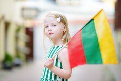 Cute little girl holding tricolor Lithuanian flag Royalty Free Stock Photos