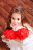 Cute little girl holding valentine's heart Royalty Free Stock Photo