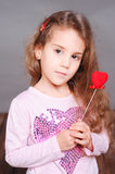 Cute little girl holding valentine's heart Royalty Free Stock Images