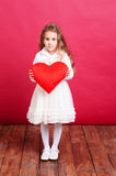 Cute little girl holding valentine's heart Royalty Free Stock Photos