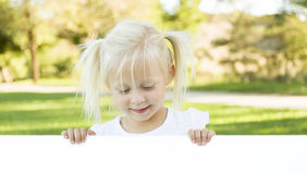 Cute Little Girl Holding White Board with Room For Text Stock Photos