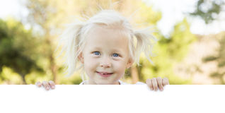 Cute Little Girl Holding White Board with Room For Text Royalty Free Stock Image