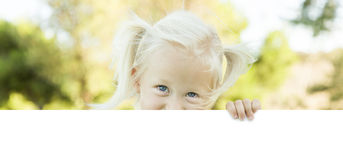 Cute Little Girl Holding White Board with Room For Text Stock Image