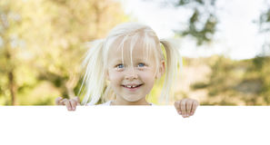 Cute Little Girl Holding White Board with Room For Text Royalty Free Stock Images
