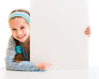 Cute little girl holding a white board Royalty Free Stock Photo