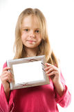 Cute little girl holdingl photo frame Stock Images