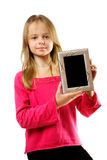 Cute little girl holdingl photo frame Stock Image