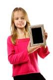 Cute little girl holdingl photo frame Stock Image