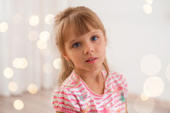 Cute little girl at home. Stock Photos