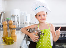 Cute little girl at home kitchen Royalty Free Stock Photo