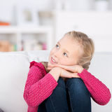 Cute little girl at home looking up Stock Image