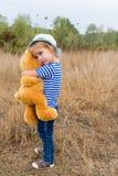 Cute little girl hugging a big Teddy bear Stock Images