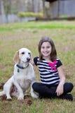 Cute little girl hugging dog Stock Photos