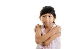 Cute little girl hugging herself in pink Royalty Free Stock Image