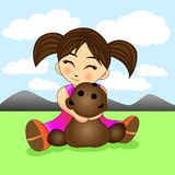 Cute little girl hugging a teddy bear Royalty Free Stock Image