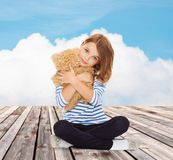 Cute little girl hugging teddy bear Stock Photo