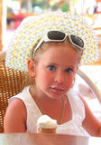 Cute little girl with ice-cream. Portrait of cute little girl with ice-cream Royalty Free Stock Image