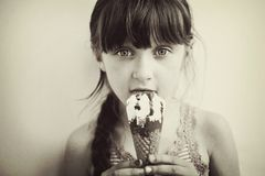 Cute little girl with ice cream in studio Royalty Free Stock Photography
