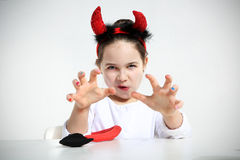 Cute little girl in imp Stock Photos