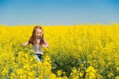 Cute Little Girl In A Field Stock Image