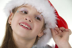 Cute Little Girl In Claus Hat Royalty Free Stock Images