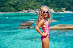 Cute Little Girl In Sun Glasses Posing On Beautiful Tropical Beach Royalty Free Stock Photos