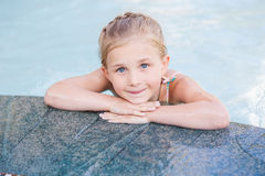Cute Little Girl In Swimming Pool Royalty Free Stock Photography