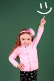 Cute little girl with index finger up Royalty Free Stock Photo