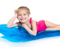 Cute little girl  on an inflatable mattress Stock Images
