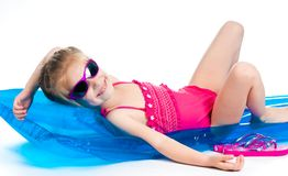 Cute little girl  on an inflatable mattress Stock Photo