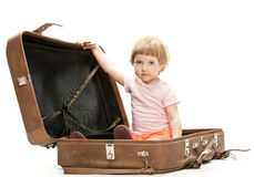Cute little girl inside a big suitcase Royalty Free Stock Photography