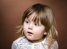 Cute little girl interesting in something Royalty Free Stock Images