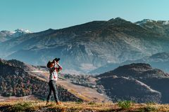 Cute little girl investigating Alps mountains using binocular. T. Cute little girl investigating Alps mountains using binocular, Switzerland. Touristic concept Royalty Free Stock Photography