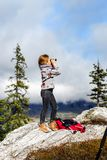 Cute little girl investigating Alps mountains using binocular. T. Cute little girl investigating Alps mountains using binocular, Switzerland. Touristic concept Royalty Free Stock Photos