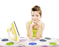 Cute little girl ironing clothes Stock Photography