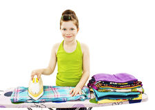 Cute little girl ironing clothes Royalty Free Stock Photo