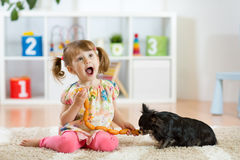 Free Cute Little Girl Is Feeding Sausages To Her Dog Royalty Free Stock Photos - 95205058
