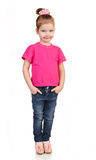 Cute little girl in jeans and t-shirt isolated Royalty Free Stock Images