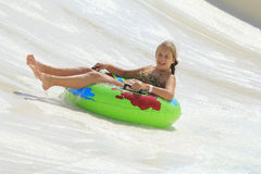 The cute little girl joying  in the water park Royalty Free Stock Photography