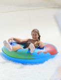 The cute little girl joying  in the water park Stock Image