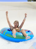 The cute little girl joying  in the water park Royalty Free Stock Photo