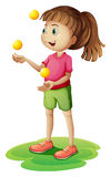 A cute little girl juggling Royalty Free Stock Photography