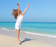 Cute little girl jumping on the beach Royalty Free Stock Photography