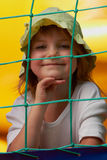 Cute little girl in a jumping castle. Pretty young girl posing in a bouncing castle in a bright sunny day with beautiful smile Stock Photos