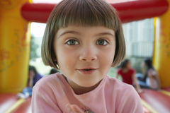 Cute Little Girl In Jumping Castle. Closeup portrait of cute little girl in jumping castle Royalty Free Stock Image