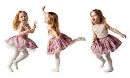 Cute little girl jumping with joy isolated on white background. Little cute girl jumping, running, dancing, having fun. Isolated on white background Royalty Free Stock Photography