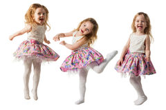 Cute little girl jumping with joy isolated on white background. Little cute girl jumping, running, dancing, having fun. Isolated on white background Stock Images