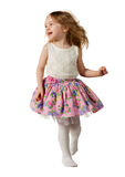 Cute little girl jumping with joy isolated on white background. Little cute girl jumping, running, dancing, having fun. Isolated on white background Royalty Free Stock Photo