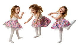 Cute little girl jumping with joy isolated on white background. Little cute girl jumping, running, dancing, having fun. Isolated on white background Royalty Free Stock Image