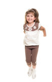 Cute little girl jumping in the studio Royalty Free Stock Image